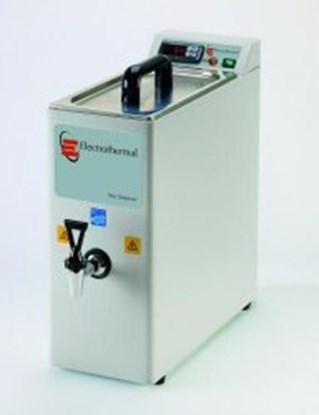 Slika za parrafin wax dispenser